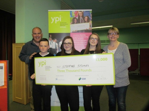 Aidan, Elle and Kerrie with members of their chosen charity Caithness Mental Health Support Group