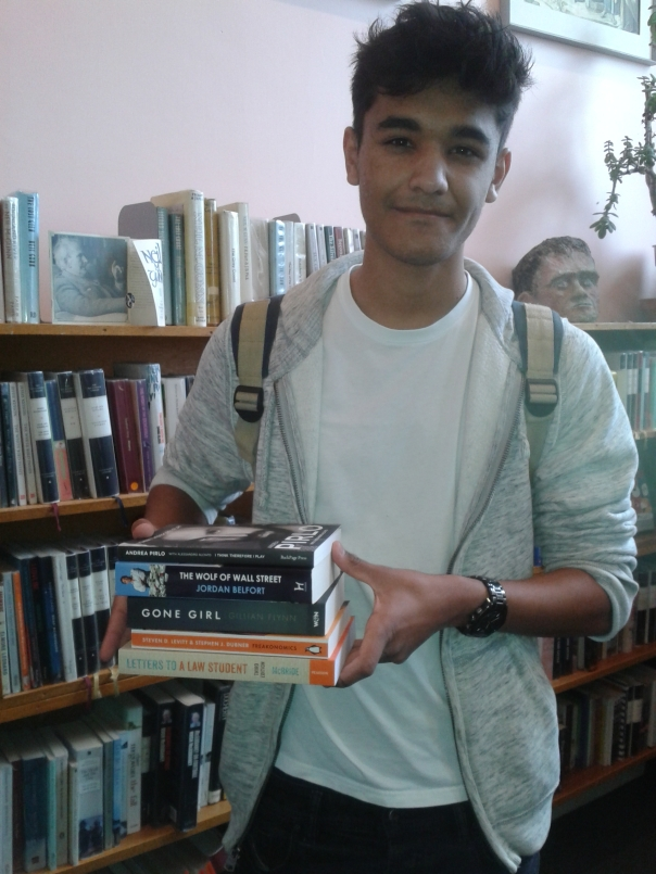 Scott Cormack with the books he kindly donated to our library