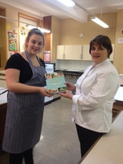Winner Ellie Robinson receiving her prize from judge Alison Mackay