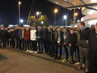 The lucky lads chosen to meet the players from the team bus.