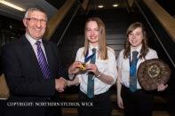 William Watt presents Sarah Sinclair with The Dux Medal while Mari-Ann Ganson receives the Proxime Accessit to The Dux.