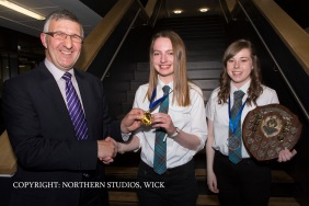 William Watt presents Sarah Sinclair with The Dux Medal while Mari-Ann Ganson receives the Proxime Accessit to The Dux.